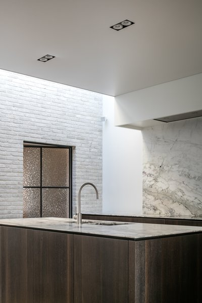 Kitchen, Marble Counter, Marble Backsplashe, Ceiling Lighting, Recessed Lighting, and Undermount Sink  Best Photos from Circu House