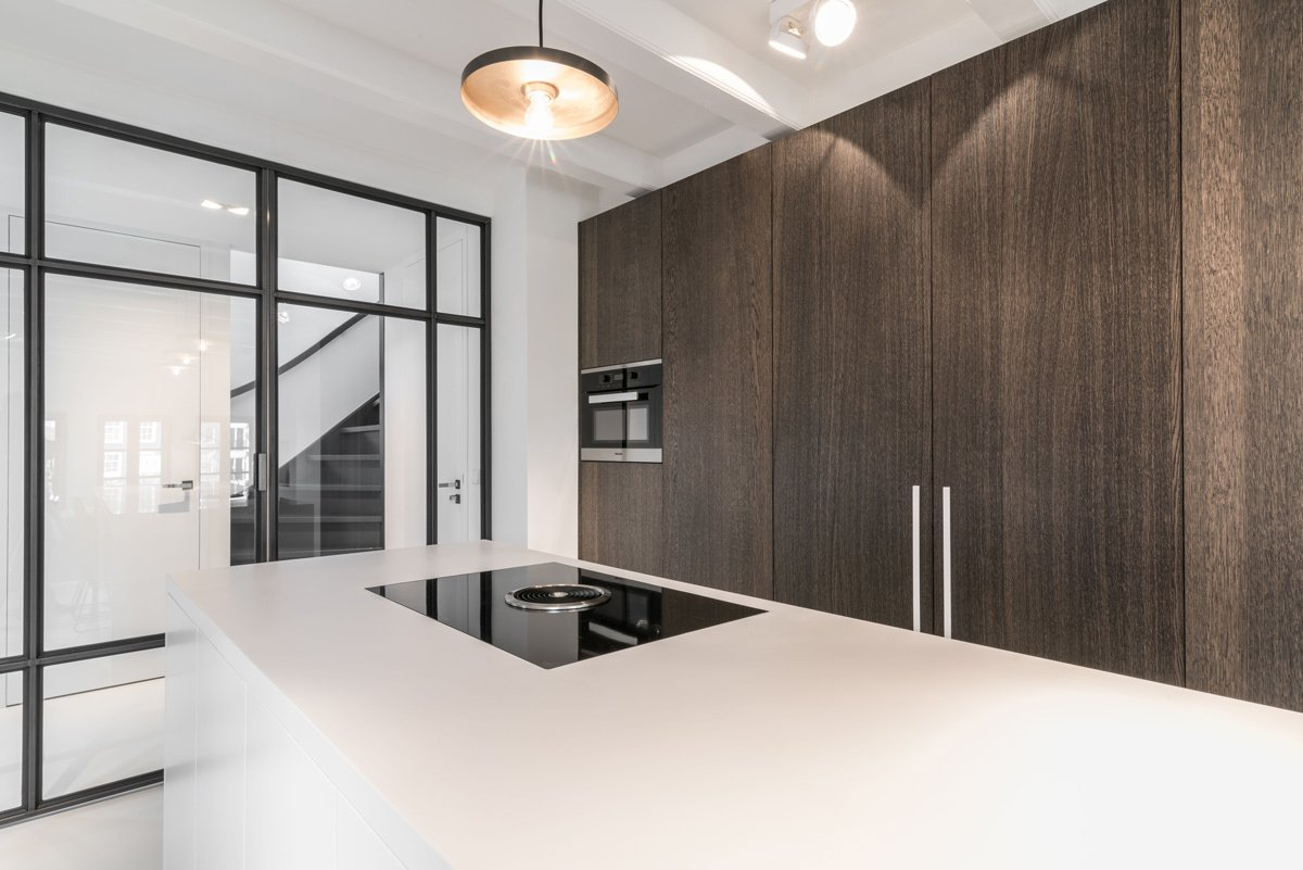 Kitchen, Cooktops, Wood Cabinet, Pendant Lighting, and Engineered Quartz Counter  Project CC