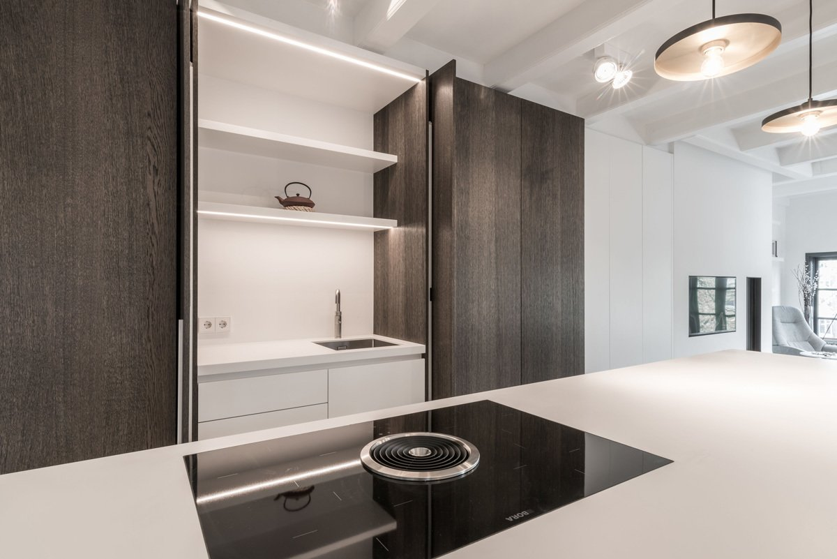 Kitchen, Cooktops, Undermount Sink, Wood Cabinet, Engineered Quartz Counter, and Pendant Lighting  Project CC