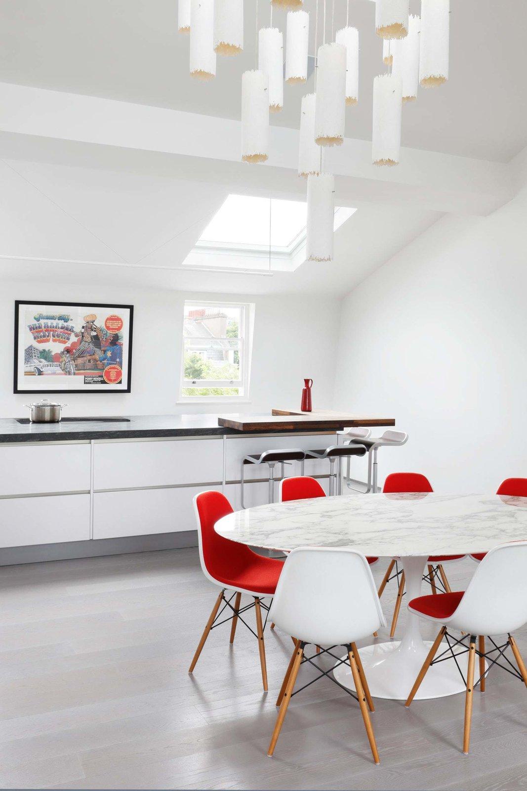 Kitchen, Granite Counter, White Cabinet, Light Hardwood Floor, and Pendant Lighting  Maida Vale Apartment