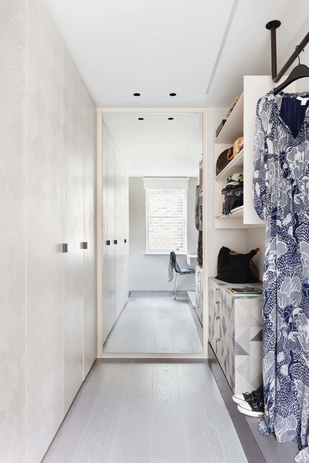 Bedroom, Ceiling Lighting, Light Hardwood Floor, and Chair  Maida Vale Apartment
