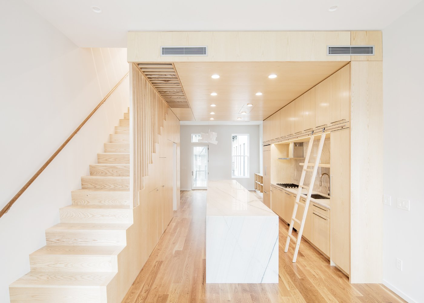 Kitchen, Marble Counter, Wood Cabinet, Medium Hardwood Floor, Marble Backsplashe, and Recessed Lighting  Wayne Street Row House