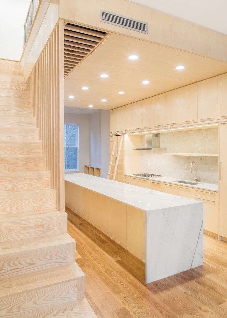 Kitchen, Medium Hardwood Floor, Marble Counter, Recessed Lighting, and Marble Backsplashe  Wayne Street Row House