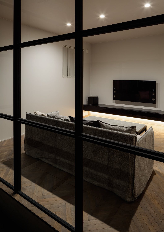 Living Room, Sofa, Dark Hardwood Floor, and Recessed Lighting  Residence in Takariya