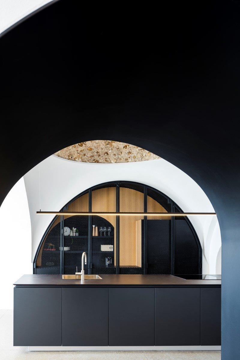 Kitchen, Granite Counter, Terrazzo Floor, Track Lighting, and Undermount Sink  Old Jaffa House