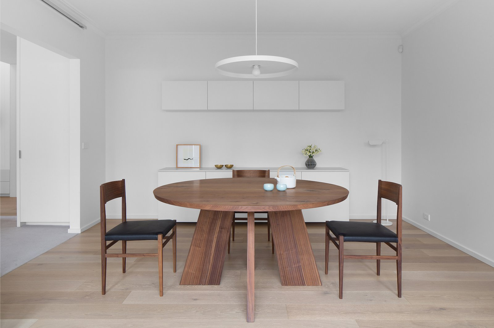 Dining Room, Chair, Table, Pendant Lighting, and Light Hardwood Floor  Corhampton Rd Residence