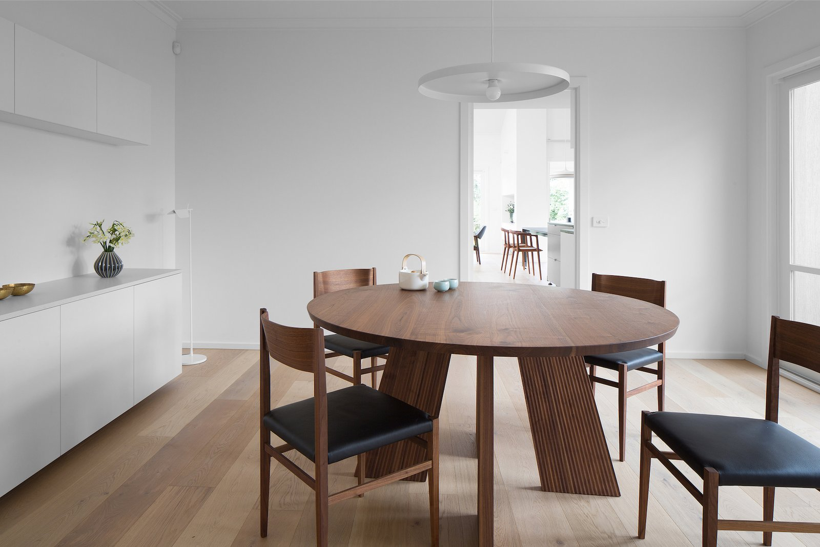 Tagged: Dining Room, Chair, Table, Pendant Lighting, and Light Hardwood Floor.  Corhampton Rd Residence by Leibal