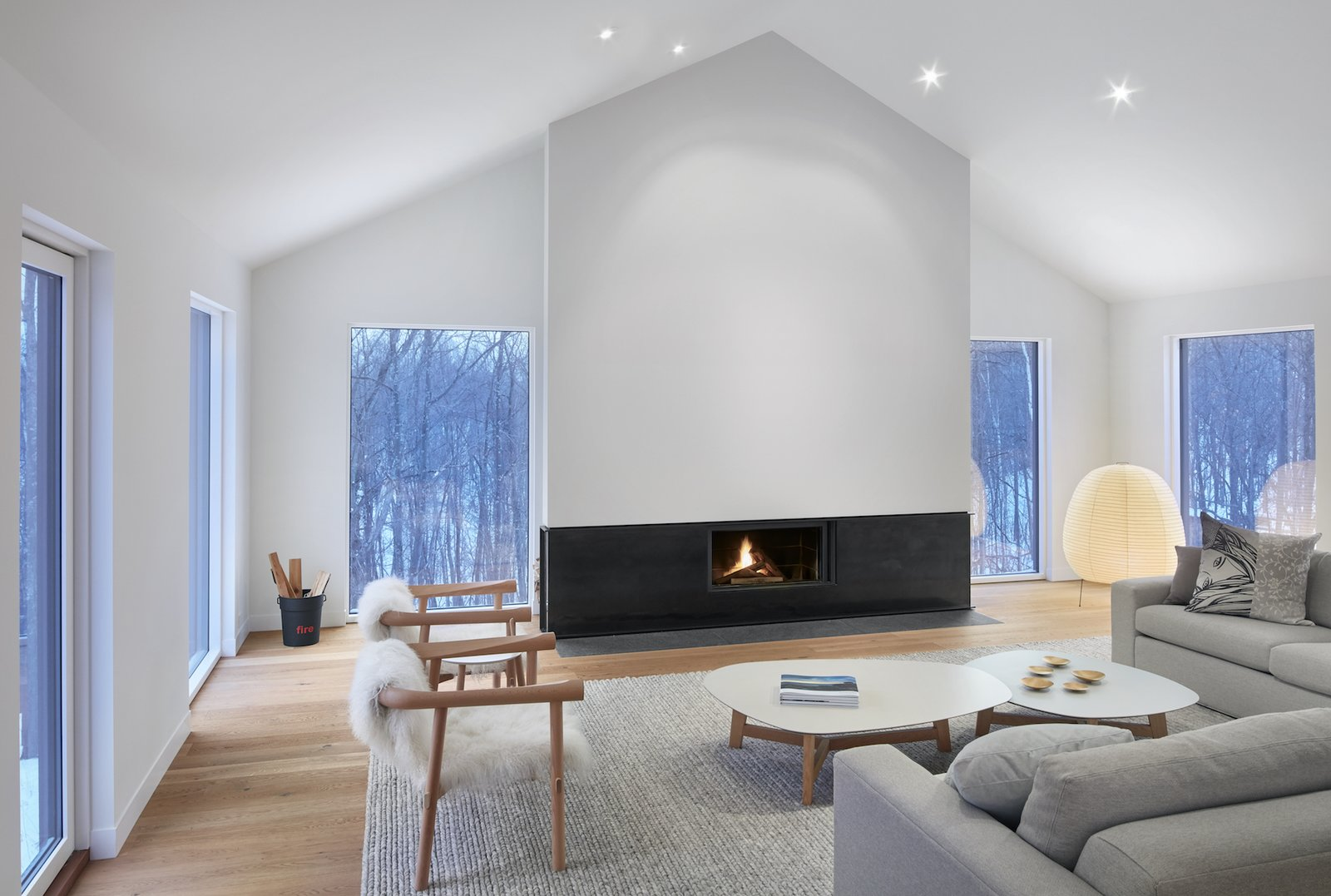 Living Room, Standard Layout Fireplace, Light Hardwood Floor, Chair, and Recessed Lighting  Alta Chalet
