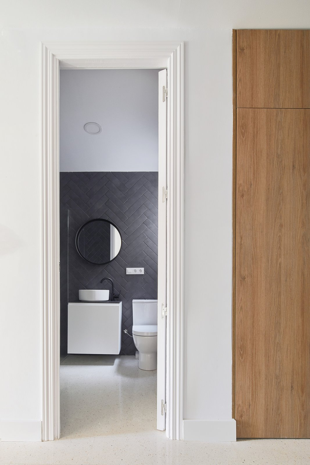 Bath Room, Vessel Sink, Recessed Lighting, Stone Tile Wall, and One Piece Toilet  Master Bath