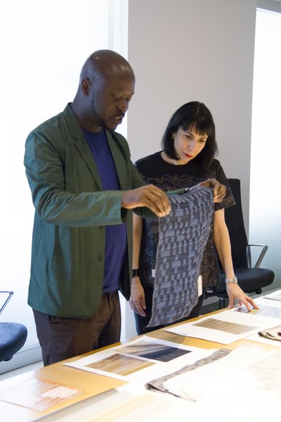 David Adjaye with Dorothy Cosonas reviewing Dakar drapery from The Adjaye Collection for KnollTextiles. Photography by KnollTextiles.