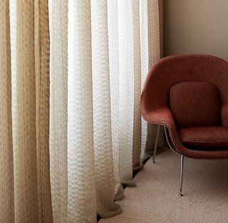 Kampala-upholstered Womb Chair with Dakar drapery. Photography by KnollTextiles.