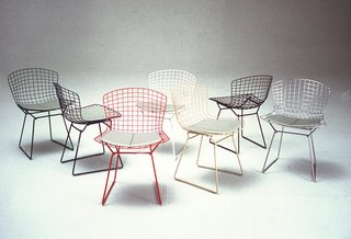 Bertoia Side Chairs shown in green, blue, white, red, white, yellow, black and chrome colorways. Image from the Knoll Archive.