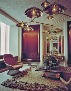 The Windows on the World reception room, designed by Warren Platner in 1976, included a Platner Easy Chair and Platner Side Table. Photograph courtesy of the Nestlé Library.