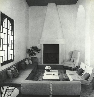 The main part of the 48-foot-long living room of York Castle, where Florence Knoll chairs were arranged around the fireplace.