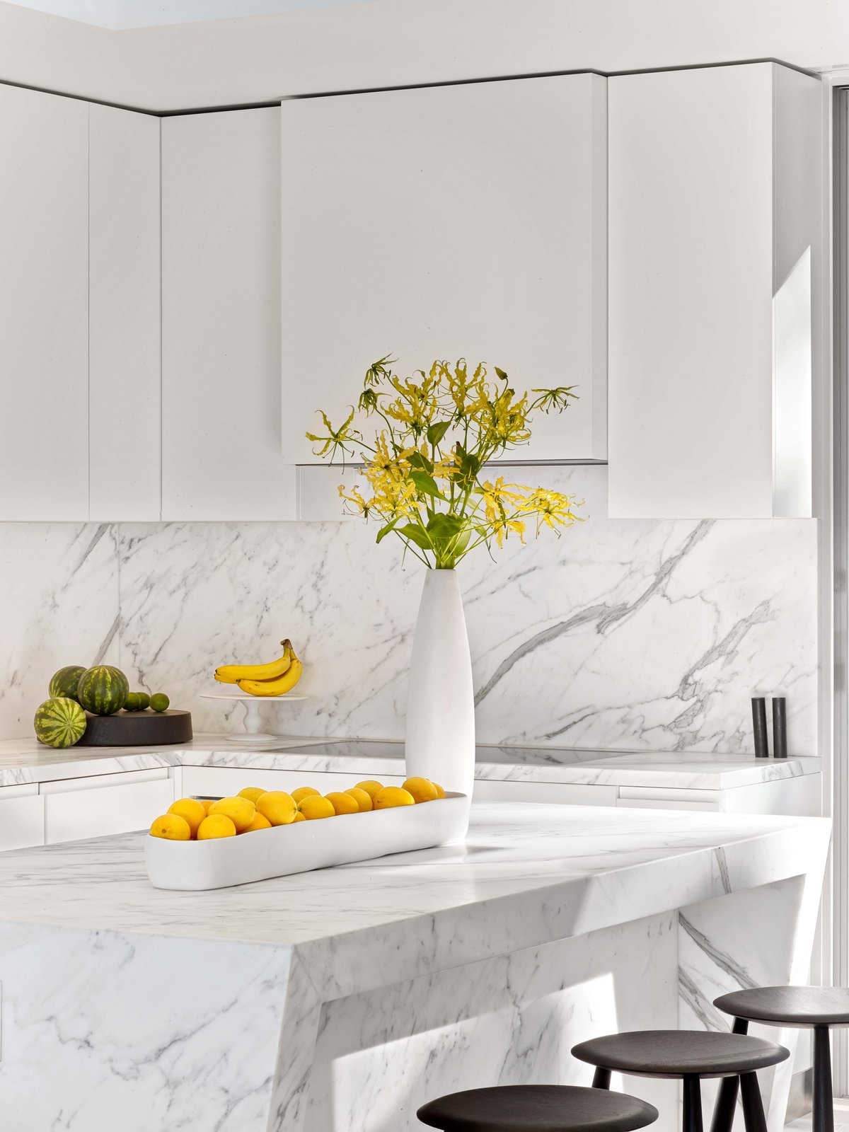 Kitchen, White Cabinet, Marble Counter, Marble Backsplashe, and Cooktops  Glen Park Residence by CCS ARCHITECTURE