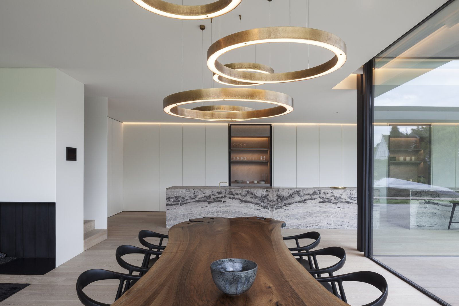 Dining Room, Table, Chair, Light Hardwood Floor, and Pendant Lighting  Photo 9 of 11 in 10 Minimalist and Monochromatic Homes in Belgium from Foxtail Bachelor Pad