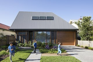 "Porjazoski thought that reinterpreting a traditional pitched roof in a highly angled form would set the home apart from its neighbors. The roof is made from Colorbond Custom Orb in ""Wallaby."""