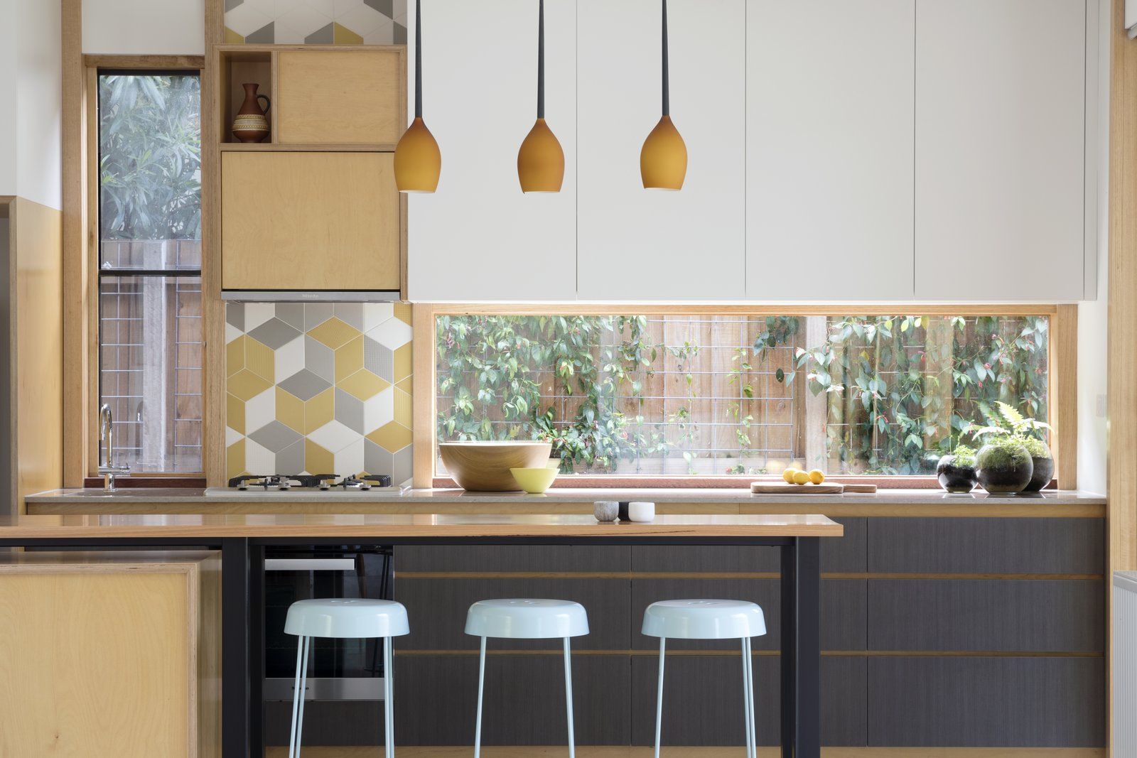 Kitchen, Range, Drop In Sink, White Cabinet, Pendant Lighting, and Ceramic Tile Backsplashe Flexi  Photo 6 of 10 in A Family Home in Australia Features a Playful Version of the Classic Pitched Roof