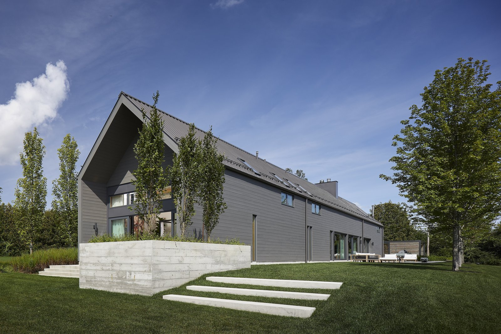 Exterior, Farmhouse Building Type, Wood Siding Material, Gable RoofLine, and Metal Roof Material  Best Photos from This Modern Farmhouse Outside Toronto Makes Its Own Rules