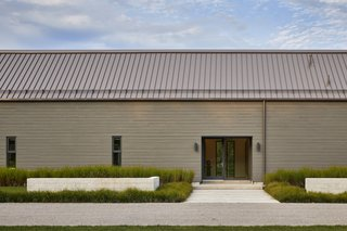 """This Modern Farmhouse Outside Toronto Makes Its Own Rules - Photo 1 of 11 - """"Most of the house is on one level, where the connection to the ground is seamless,"""" he says. Kolbe windows and doors are used throughout the home."""
