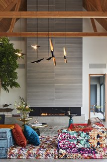 """This Modern Farmhouse Outside Toronto Makes Its Own Rules - Photo 3 of 11 - """"The owner wanted some part of the house to be more cozy, and the vibrantly colored Roche Bobois sofa did the trick,"""" Posno says. Bell Side Tables by Sebastian Herkner and a Coltrane suspension ceiling lamp by DelightFULL complete the look."""
