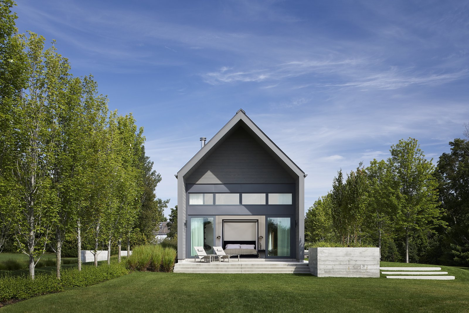 Outdoor, Back Yard, Grass, Shrubs, Small Patio, Porch, Deck, and Trees  Photo 11 of 12 in This Modern Farmhouse Outside Toronto Makes Its Own Rules