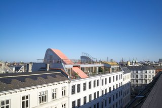 "De Smedt knew the ultra-modern look of the rooftop garden's design would draw attention from the surrounding neighbors, so he and his team worked with the municipality to agree on a form that received everyone's approval. ""The process was a bit longer but still smooth,"" he says. ""We ended up with Copenhagen's mayor coming to cut the red ribbon and open the project!"""