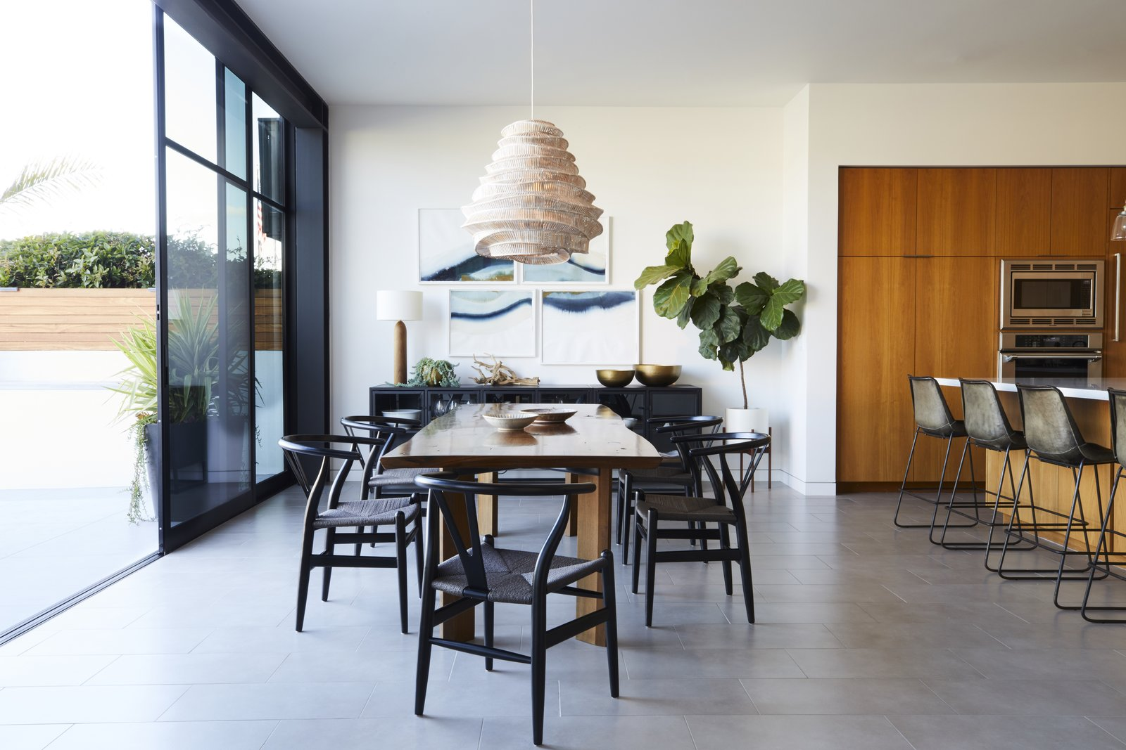 Dining Room, Lamps, Chair, Table, Stools, Storage, Pendant Lighting, Bar, and Table Lighting  Best Photos from This Renovation Will Make You Rethink the Typical Look of a California Beach House