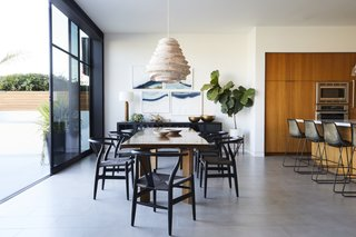 """The owners really wanted to make sure that the furniture was inviting and interesting, but still felt like it fit the space,"" DeSanti says. ""Martha designed a great open space, but without the furniture the space could have felt very cold."" France and Son supplied the chairs around the custom dining table, and the chandelier was spotted at Roost."