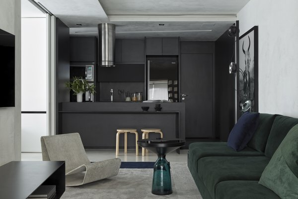 Since the owner wanted as much of an open concept as possible, Revollo used a small but impactful detail to designate each space: color. The kitchen is defined by black, the living areas by gray, and the outdoor space by honey.