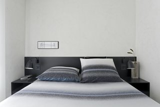 The black lacquer finish used in the common area was repeated in the design of a headboard for the master bedroom.