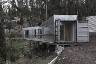This Off-Grid Container Home in Australia Disappears in Nature - Photo 2 of 8 - One end of the home connects to the existing access path, which helped make construction to the site as minimal as possible. Edwards also positioned the property so that a studio space could be built below the home in the future.