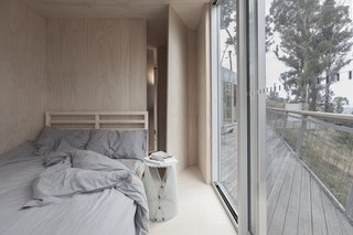 This Off-Grid Container Home in Australia Disappears in Nature - Photo 5 of 8 - The two bedrooms were made to be equally simplistic, with just enough to feel comfortable.