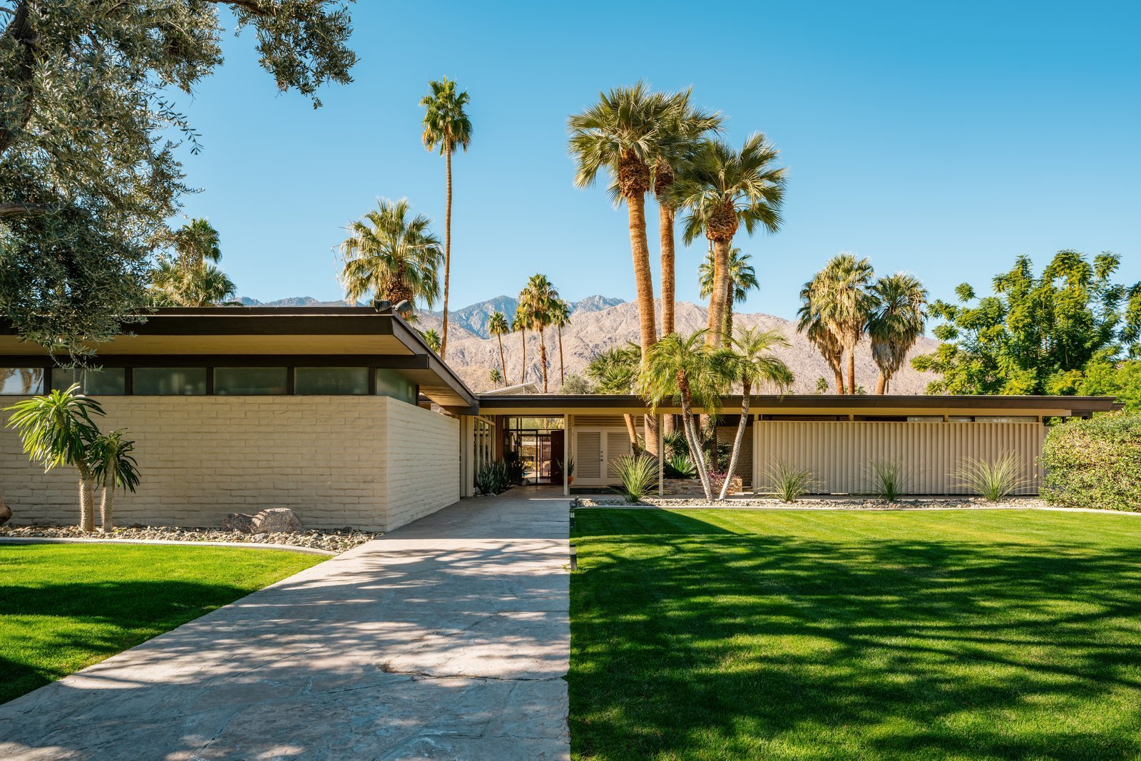 Exterior, Brick Siding Material, Mid-Century Building Type, Flat RoofLine, and House Building Type A midcentury property in Palm Springs, California.  Photo 1 of 10 in Top 10 Cities to Witness Stunning Architecture Across America