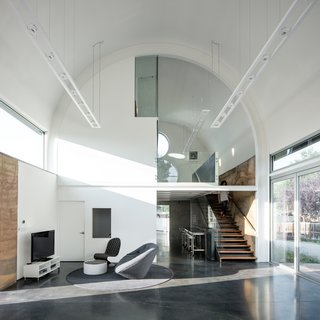 Thanks to expansive glass windows, natural light fills the space and provides an open, airy vibe.