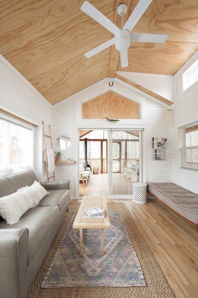 """""""We needed furniture that could be easily wiped down and rid of sand from the beach and dirt from our hikes; a leather sofa was a must,"""" she says. Jorie added a daybed to the living area as an extra space to sleep, if needed."""