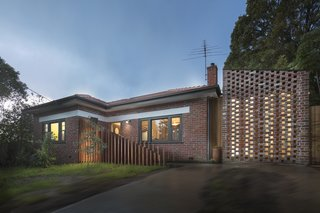 Dunin and her team repurposed recycled brick to match the original material on the exterior of the home. Brick was also used to build privacy walls that would still bring in light and air.