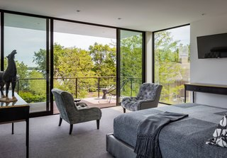 A Series 600 sliding glass door from Western Window Systems was installed between the master suite and its outdoor patio, which has expansive views of Minneapolis' Bde Maka Ska.