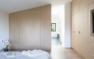 A private master bedroom and ensuite were key to the renovation, and include as much natural light as the ground floor. Benjamin Moore's White Heron was used throughout the interiors to complement the light.