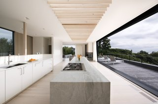Masi flipped the design of a traditional home and placed the common areas on the second level for the best ocean views. The kitchen cabinetry is custom-made, and a Thermador range sits on the island.