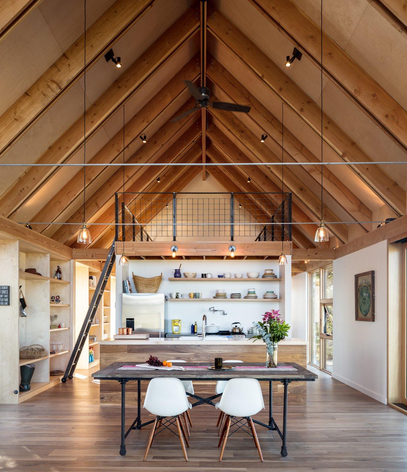 Dining Room, Chair, Pendant Lighting, Medium Hardwood Floor, Shelves, Table, and Ceiling Lighting  Big Cabin | Little Cabin by Renée del Gaudio Architecture