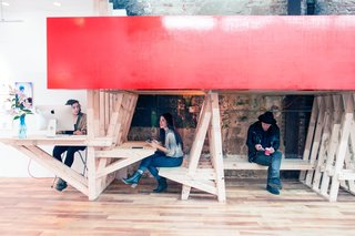 The Con Artist Collective accommodates both artist studio space and art storage with innovative structures.