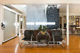 An Amazing Tree-Covered Glass House For Sale in the Berkeley Hills - Photo 13 of 20 - Though there are many parts of the home the family felt were special, they had a particular fondness for the original mural by artist Claire Falkenstein, which was prominently installed at the home's entrance.