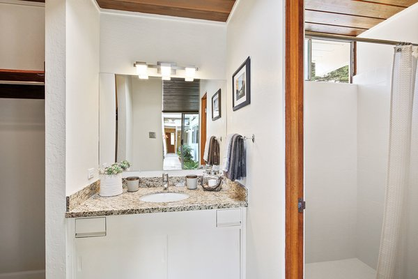 Simply updated, the adjoined master bathroom has a bright shower and spacious walk-in closet.