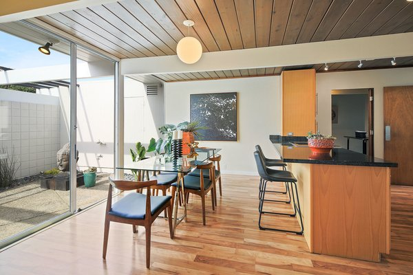 Natural wood-plank ceilings remain beautifully intact in the single-level, post-and-beam home.