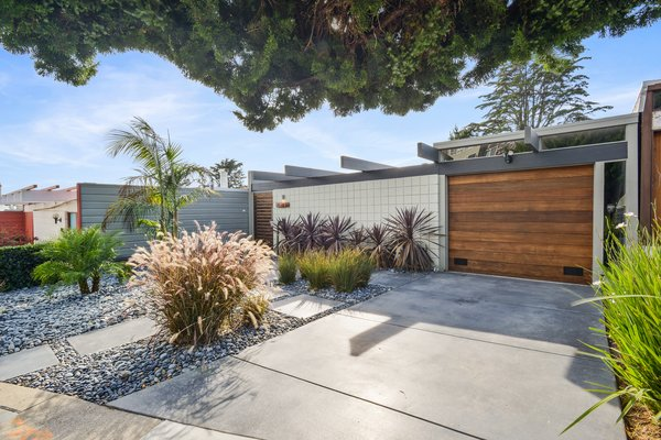 With a street presence that's modest in scale, 1027 Duncan Street exemplifies the post-and-beam construction that's typically found in Eichlers.