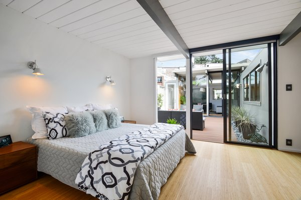 The courtyard-adjacent master bedroom enjoys visual and functional integration with the outdoors.