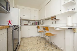 Cozy and charming, the house's original kitchen remains intact.