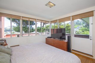 The master bedroom is connected to the home's largest outdoor terrace, substantially increasing usable living space.