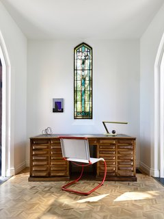 Original parquet floors were preserved throughout the house, including in the beautifully minimal study nook.